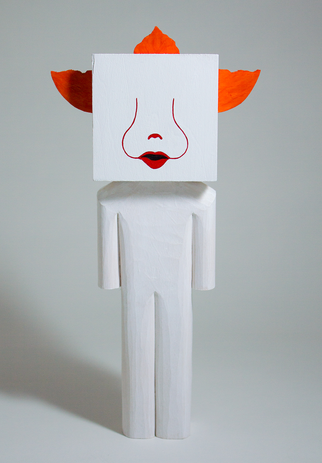 """""""Pennywise the Dancing Clown"""" Basswood and acrylic. 8 x 4 x 2 inches. CSK 013G"""