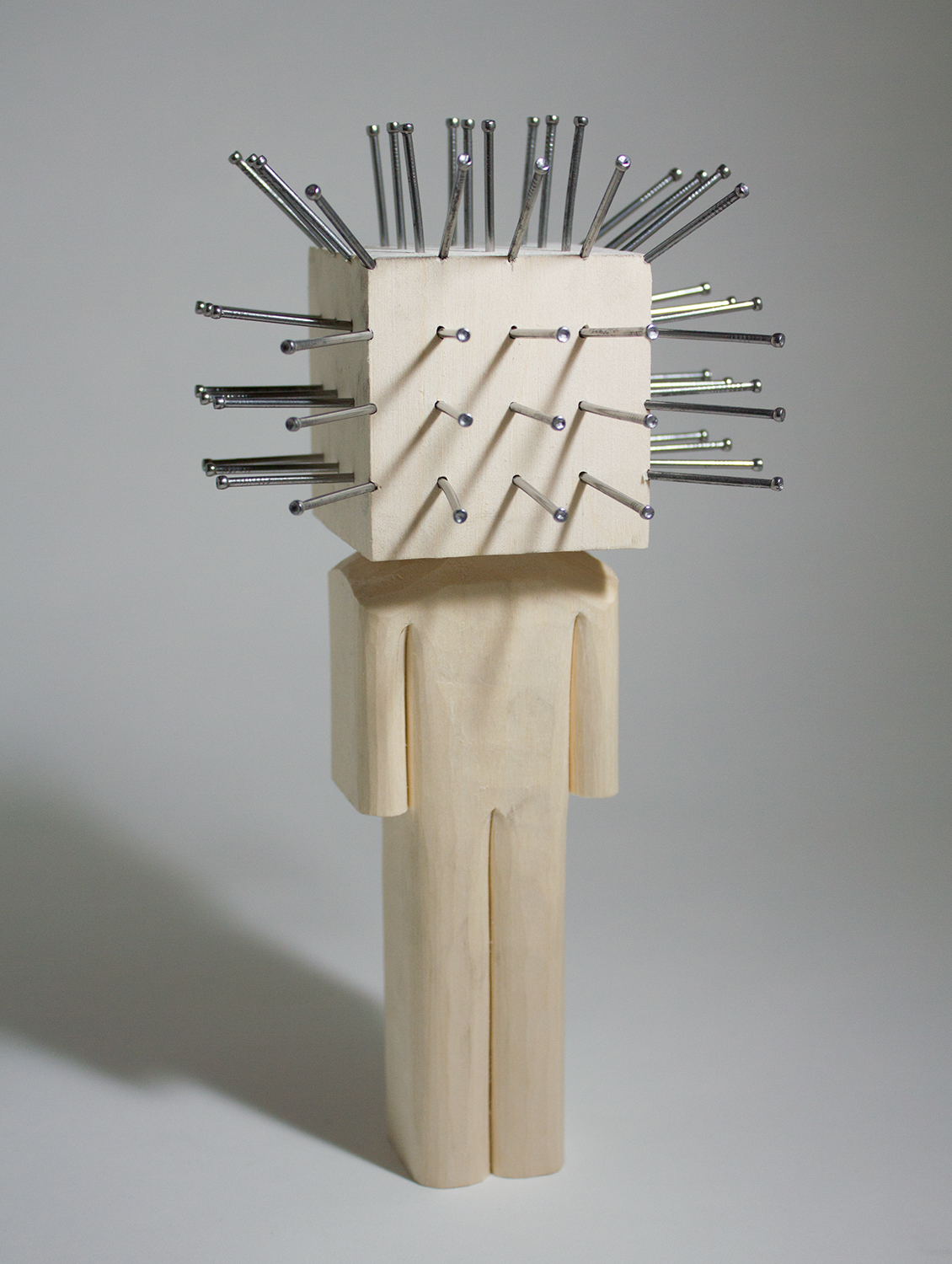 """""""Pinhead"""" Basswood and nails. 8.5 x 4.5 x 3.25 inches. CSK 012G"""