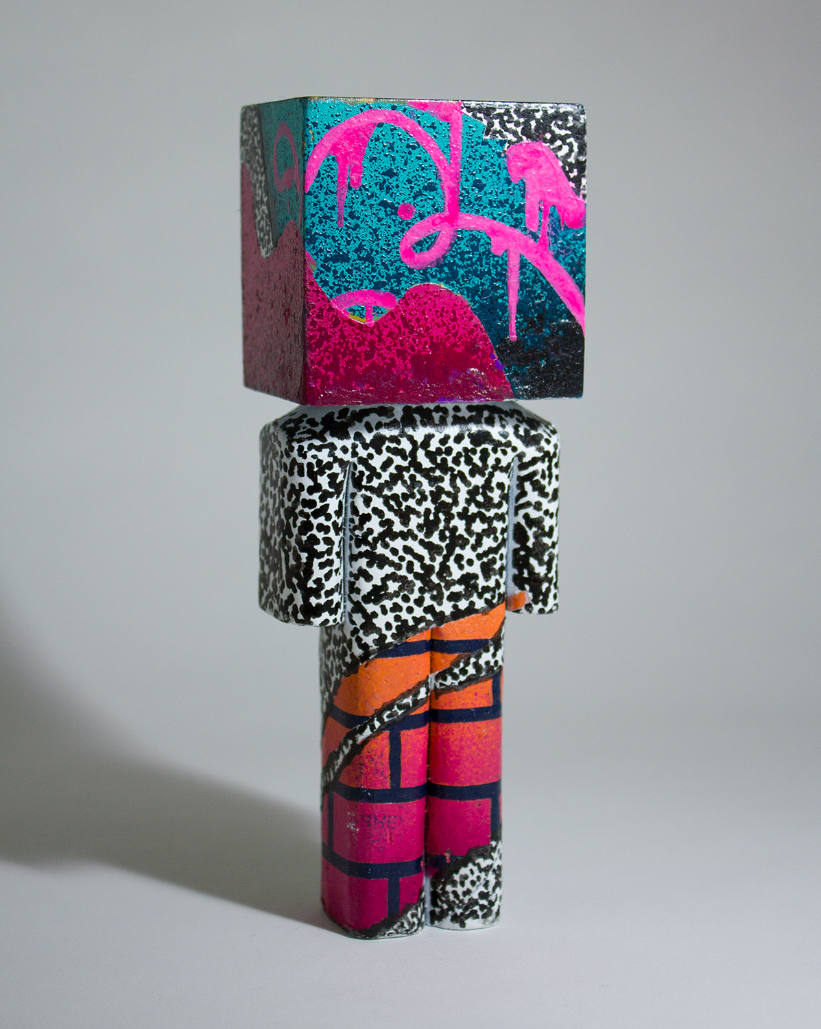 """""""Scatterbrained"""" Collaboration with Matt Field. Basswood, spray paint, and paint pen. 6.5 x 2.25 x 1.75 inches. CSK 018G"""