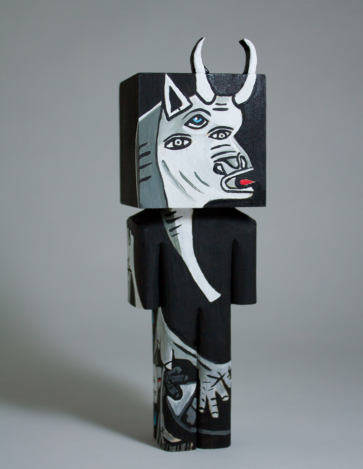 """""""Woke Bull"""" Collaboration with Donna Howells. Basswood and acrylic. 7.5 x 2.25 x 2 inches. CSK 023G"""