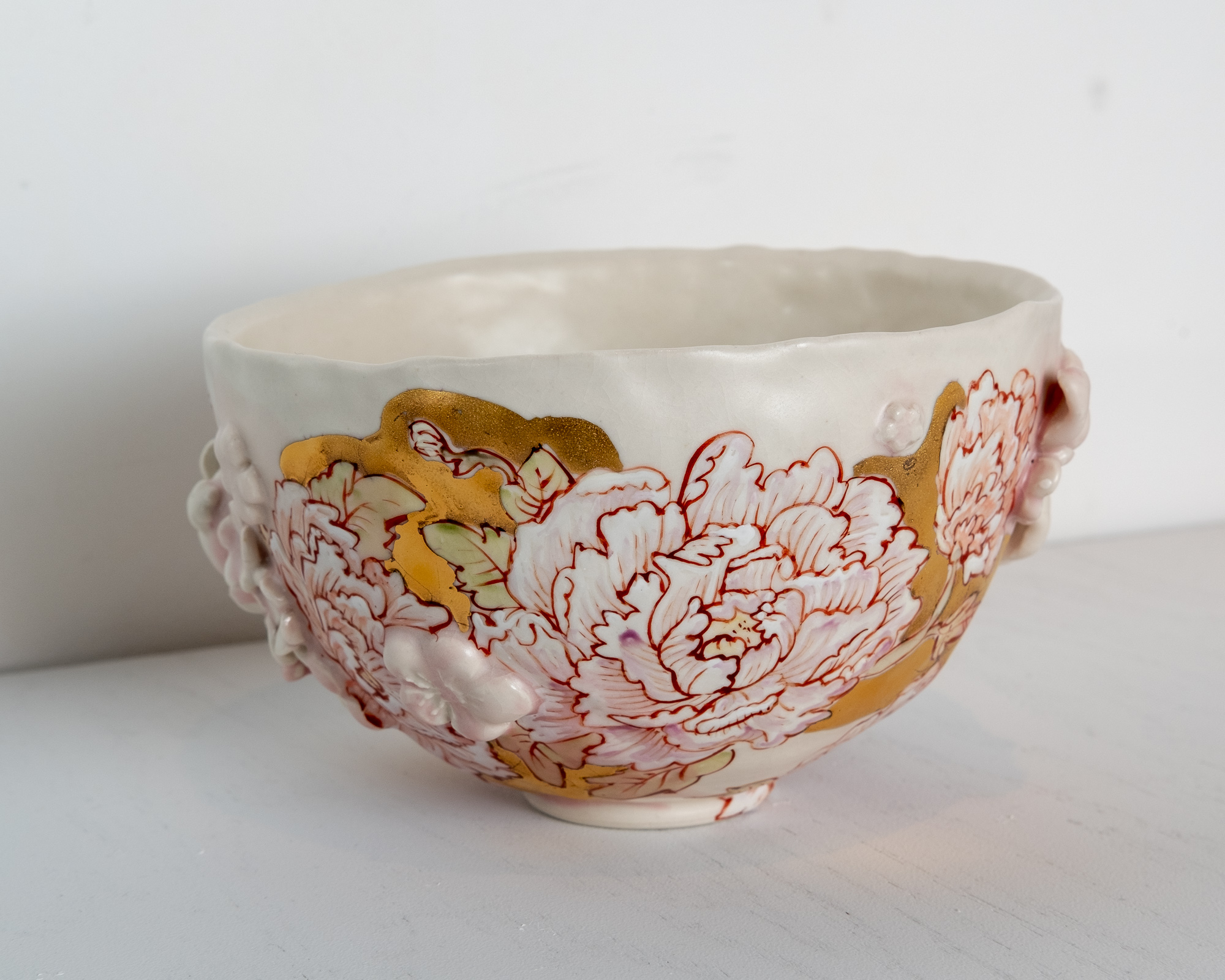 Peonies Teabowl  H andbuilt porcelain with hand-molded sprigs, glaze, overglaze drawing, raised Kutani enamels, gold  6 x 6 x 6 inches VZI 013G