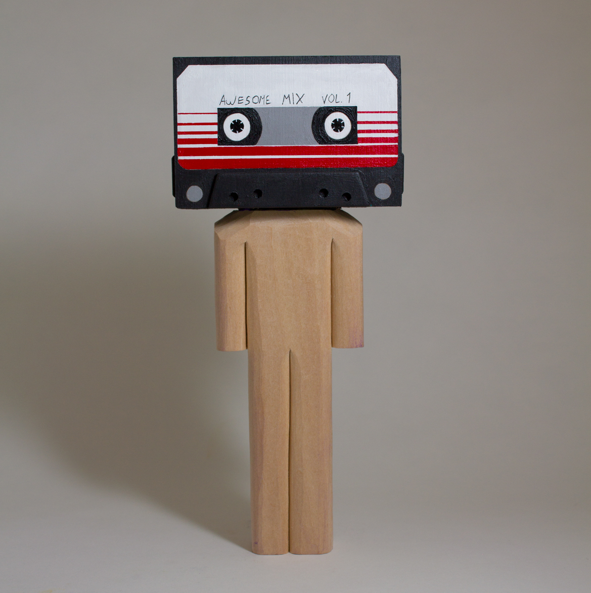Awesome Mix Vol 1    basswood and acrylic  3.8 x 1.75 x 8.5 inches  CSK 038G
