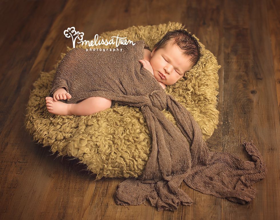 This little love arrived to the studio for his newborn mini session and we captured magic.  Our newborn mini sessions are a new option we offer for those looking for a few special captures in an affordable manner.    We styled him with organic textures and colors and the result was an amazing rustic feel which lends the perfect masculine touch.