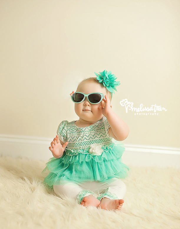 """Sunshine is on the way ... we have been waiting for some beautiful sunshine in North Carolina and the temperatures are warming next week... and we are so excited to get outdoors again and capture some beautiful portraits.  This little love arrived at the studio with tons of personality for her 6 month """"sitting"""" milestone session as one of our Baby Portrait Planners. Perfectly styled in mint and cream, along with coordinating sunglasses ... she was ready to play! :)"""