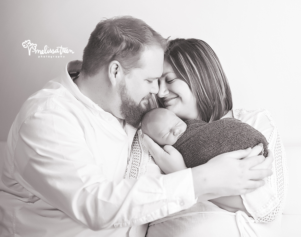 happy couple with new baby phtoo greensboro newborn photographer burlington nc.jpg