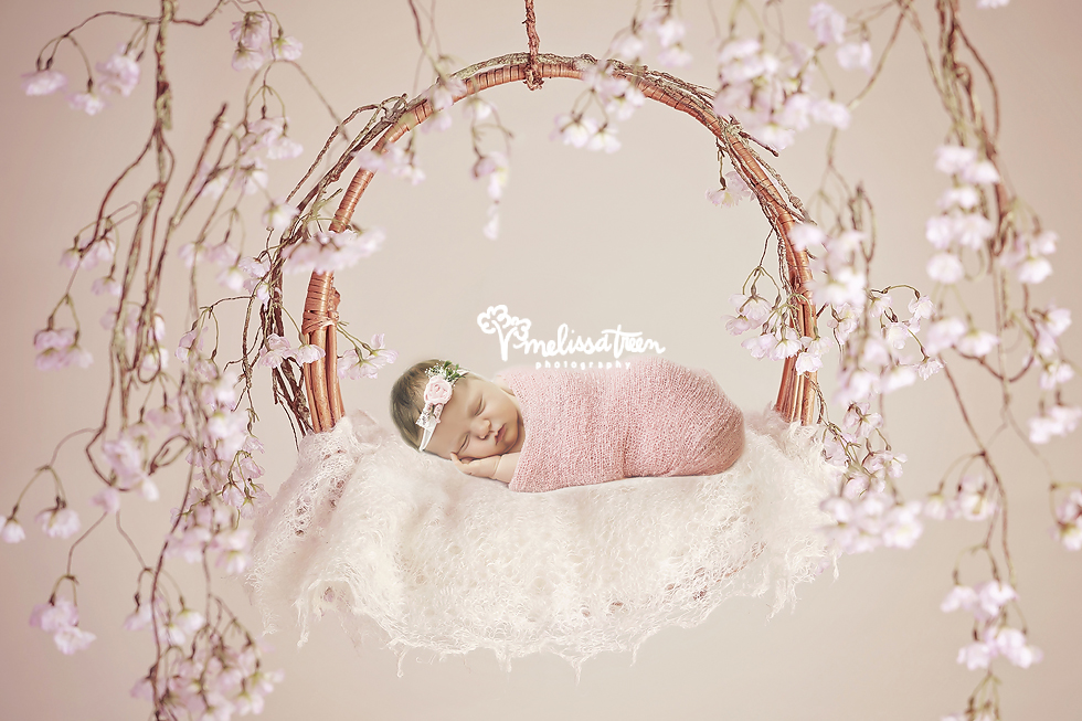 newborn-baby-on-floral-swing-greensboro-photographer-north carolina-baby-burlington-nc.jpg