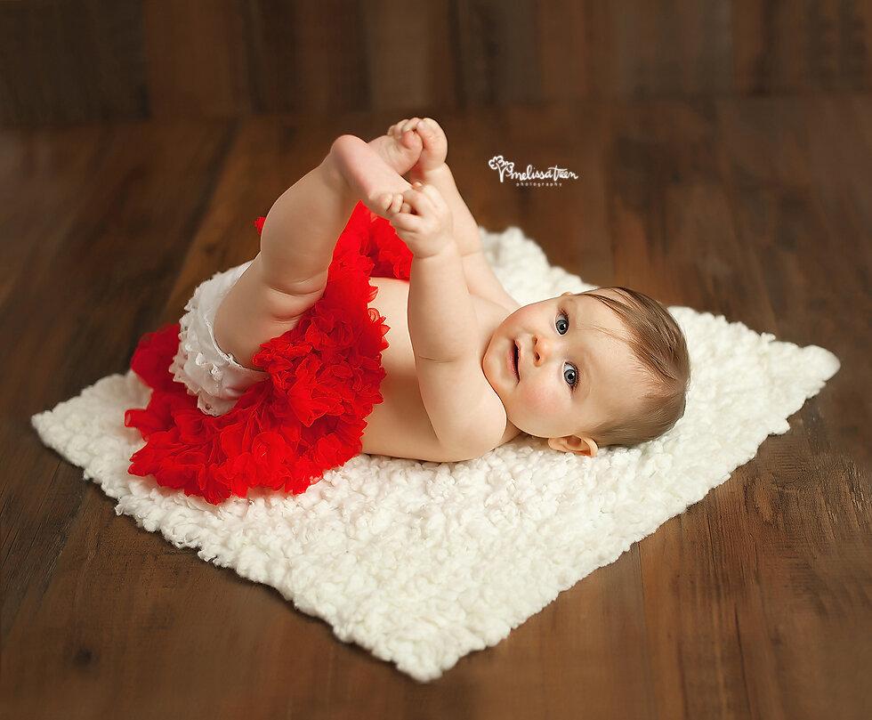 happy baby pictures in tutu 6 month baby photo greensboro north carolina photographer kernersville winston salem.jpg