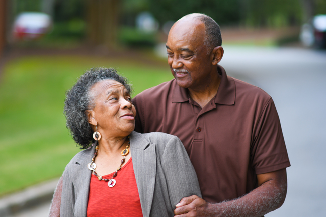 stock-photo-elderly-african-american-man-and-woman-posing-together-479909623.jpg