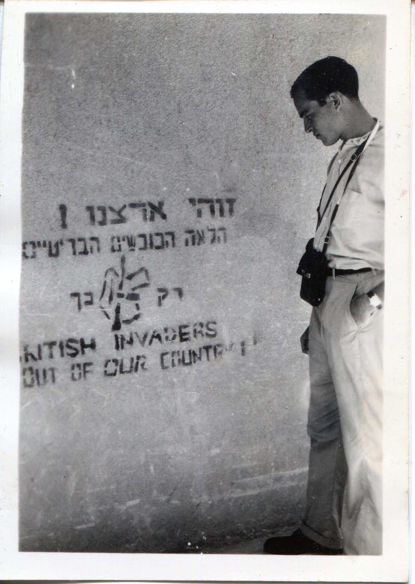 LIB looking at graffiti in Palestine 1947