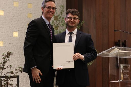 David Myers presents award to Social Justice Fellow Jacob Plitman