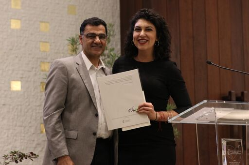 Salam Al-Marayati presents award to Social Justice Fellow Rachel Sumekh