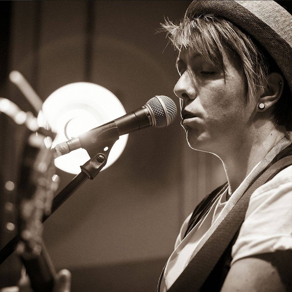 Nicola Collis - Nicola has been playing Acoustic and Electric Guitar for 25 Years. Her teaching style is very relaxed and student centred. Nicola combines the basics of theory and playing styles in a context that suits the taste of each student. She provides regular reviews of progress and direction for players.Nicola is a published Singer/Songwriter with album and EP releases under her belt. Her most recent 'Down Side Up' was released earlier this year with an accompanying video for her single 'Kiss Goodbye' (Click here to watch). As a result, she is involved with SOSLAM, providing guidance as a facilitator on songwriting for both Adults and Children. She is also able to incorporate songwriting, performance elements and technical guidance for solo performers wishing to play to audiences in her private coaching sessions.Nicola also performs professionally 2-3 times a week. As well as hosting various open mic nights in and around Southend, she performs as a solo act, duo (between2minds), in a covers band (interchange) and two original bands, including her own and as acoustic guitarist and backing vocals in 'Darren Jones and the World Music Band'.Nicola runs weekly guitar classes for children and adults and is a regular coach with the Saturday Songwriting School. Click the buttons below for more info. She is also available for 1:1 coaching in both Guitar and Songwriting, based from her private studio in Benfleet. To find out more please enter your details below.