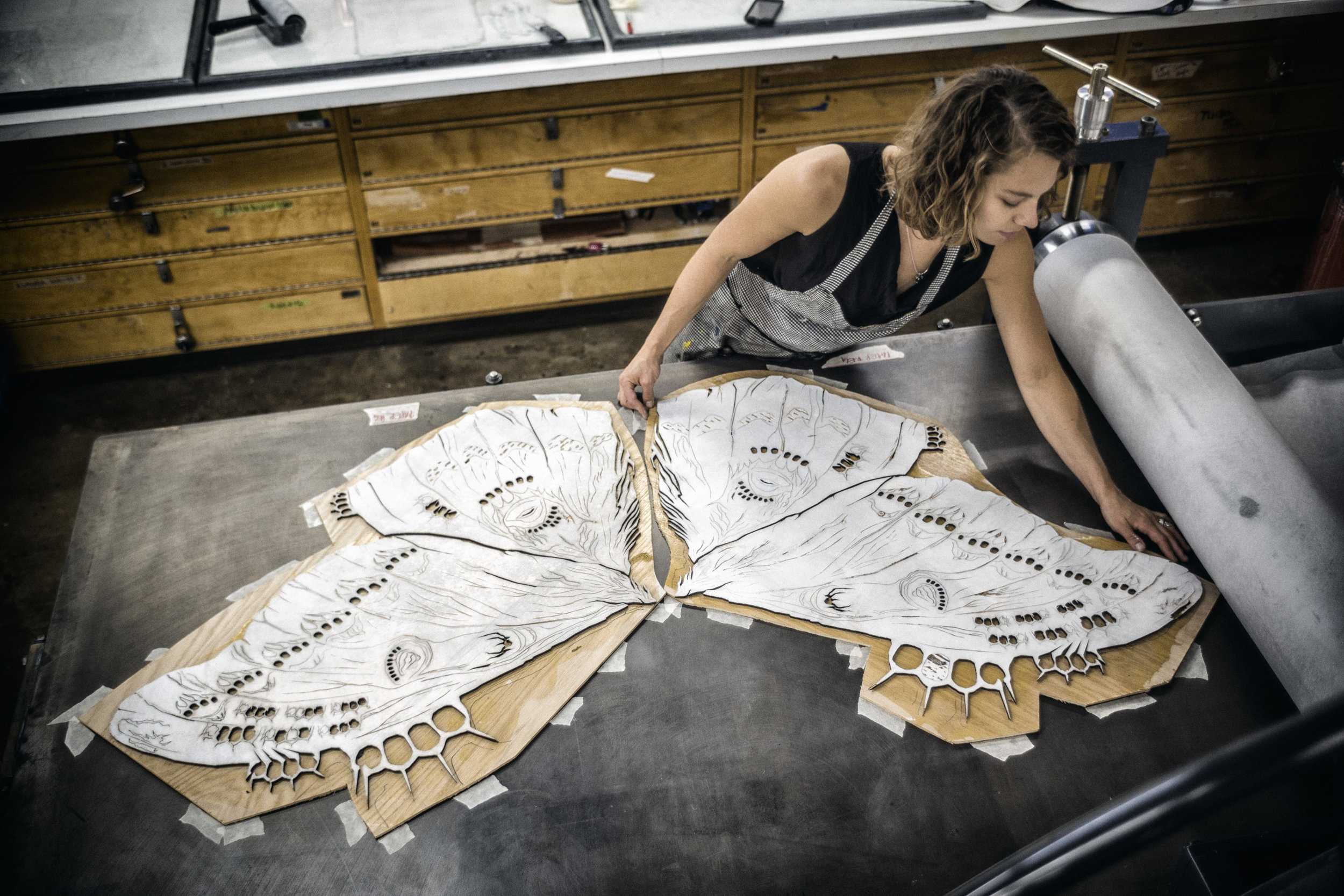 Volwiler-Stanley at the press, printing her laser-cut woodblock for the print-based installation series in  The Lawless Forest