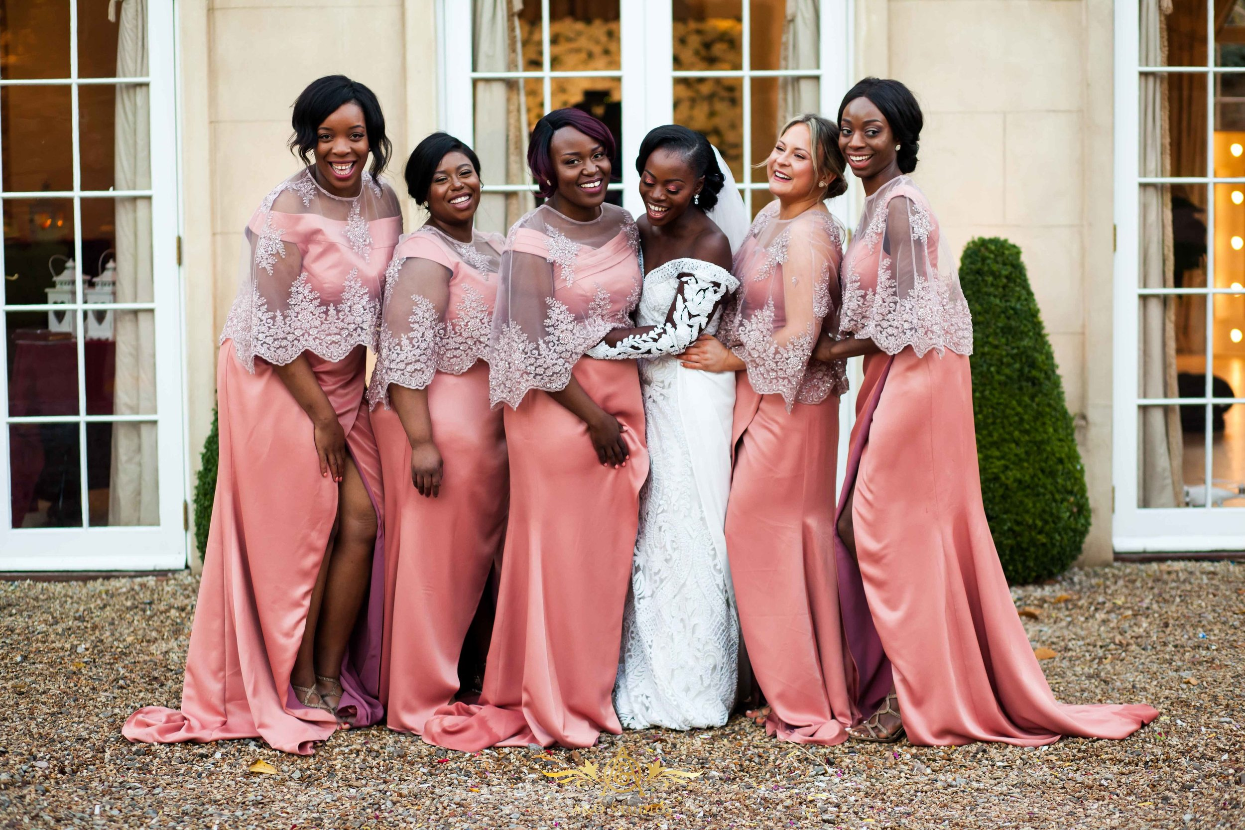 Our #KOROMAKALA bridesmaids in bespoke dresses and delicate lace capes. Note; bride is not wearing a LALI London design.