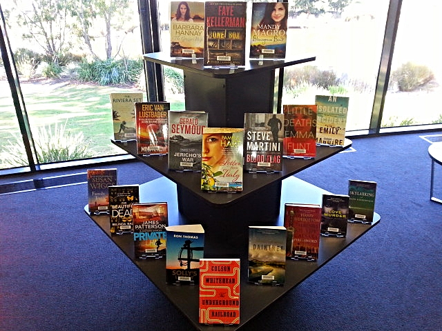This new book display is aligned so that book covers meet you as you walk past the front desk, with eye-engaging faces to the fore. Colour, contrast, symmetry, books for blokes and ladies and even a James Patterson for good measure.