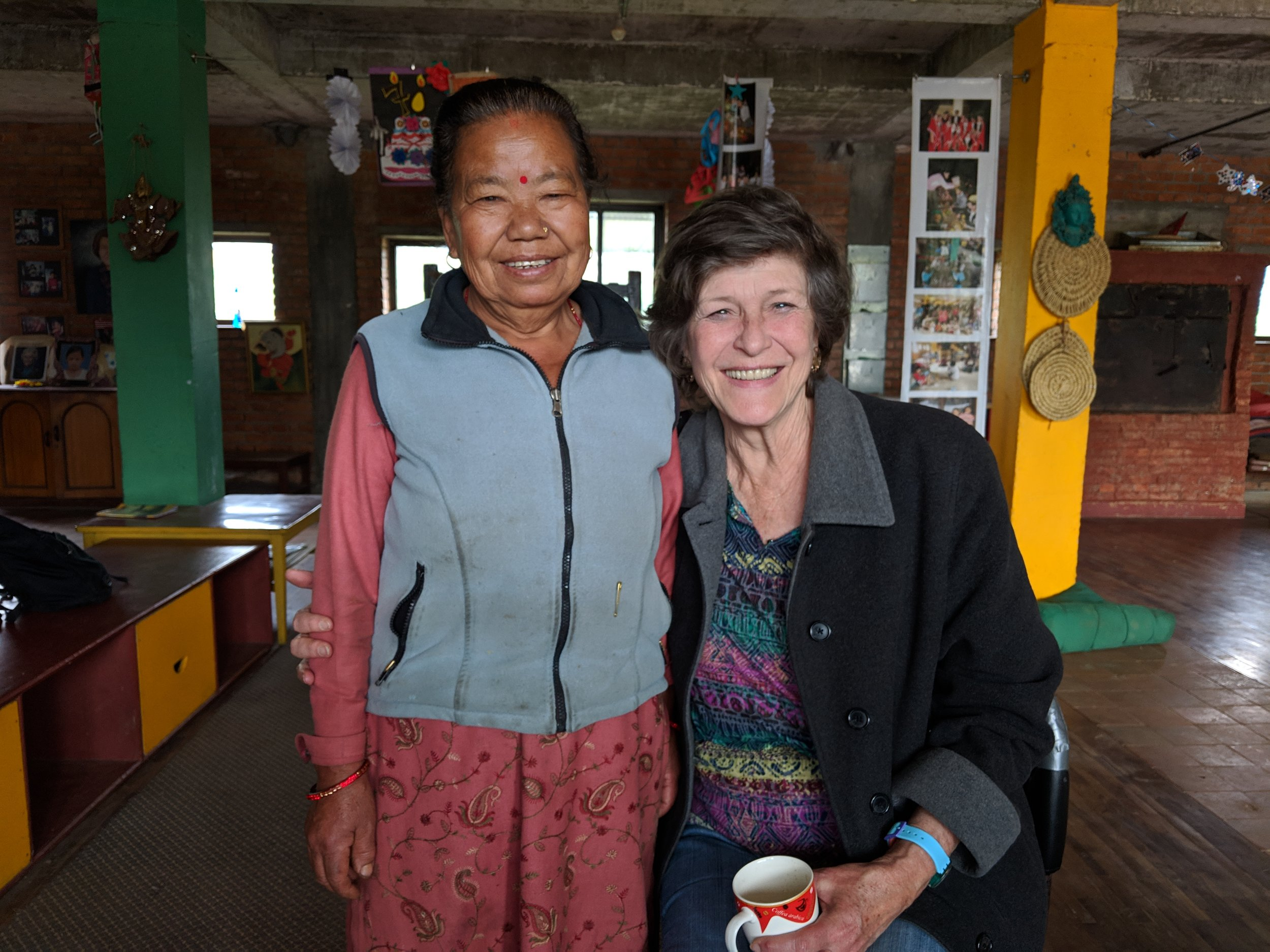 Bonnie, the director of Ama Ghar (right) with Dhana, a long-time member of the staff (left).