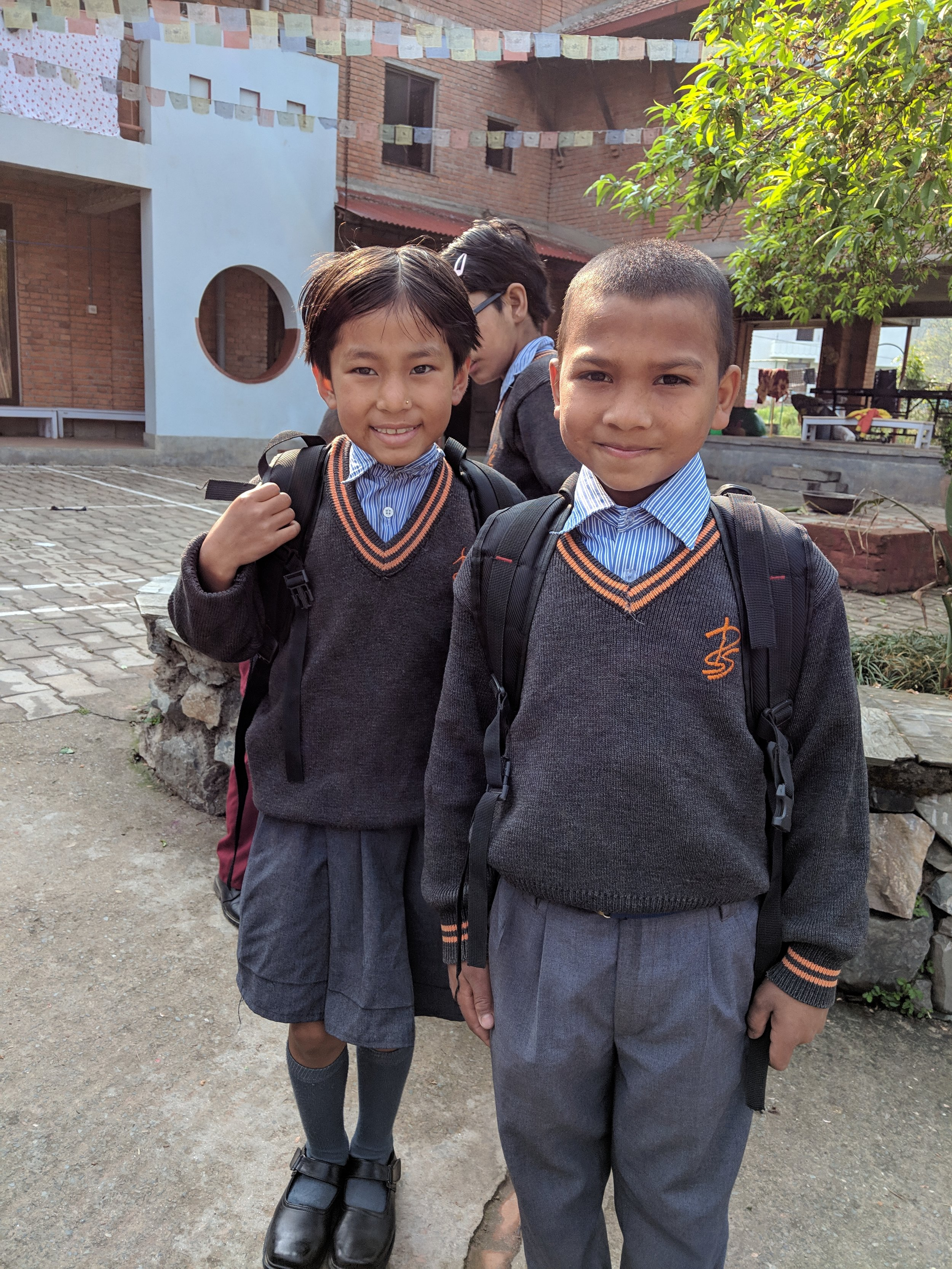 Two of the kids in their school uniforms.