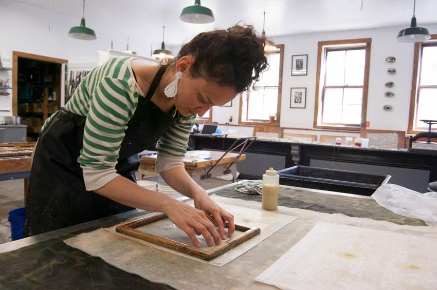 Jody working in the paper making studio at the  Women's Studio Workshop.  Photo courtesy of  Women's Studio Workshop .