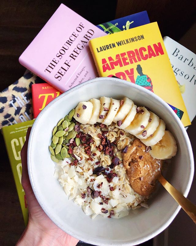 A pic of oatmeal and books, my truest loves (oat details below)💕 I can't really explain why books are such a strong form of self care for me; I don't even know if I know the extent of it myself. What I do know is that little Olivia used to read nonstop. That everyday when she got home from school, she'd go straight to the couch and read before doing homework and then again as soon as she was done. That she read so much in the car that her mom (lovingly) threatened to take her books away from her. That she'd sometimes not check over her answers on tests so she could spend the remainder of the class period reading. And when she grew, she knew all she wanted to do in life was talk about books 📚 So she didn't take science her senior year of high school, but instead doubled in English. And in college, there was no doubt about what her major would be. And now, she's working in the publishing industry and hoping to talk more about books on here in her free time, because nothing brings her more excitement than words on a page that have the ability to bring people together, educate people, or cause debate. Books have been the love of my life since as far back as I can remember, so why should I not praise them 24/7? #deats: 1/2 cup of @bobsredmill rolled oats and @salbachia chia seeds cooked in @pacificfoods unsweetened vanilla almond milk, @vitalproteins collagen, and cinnamon. Then I topped with @wholefoods pumpkin seeds, @navitasorganics cacao nibs, almond butter and @bobsredmill coconut flakes. Clearly the perfect bowl for any book you're cozying up with 😜