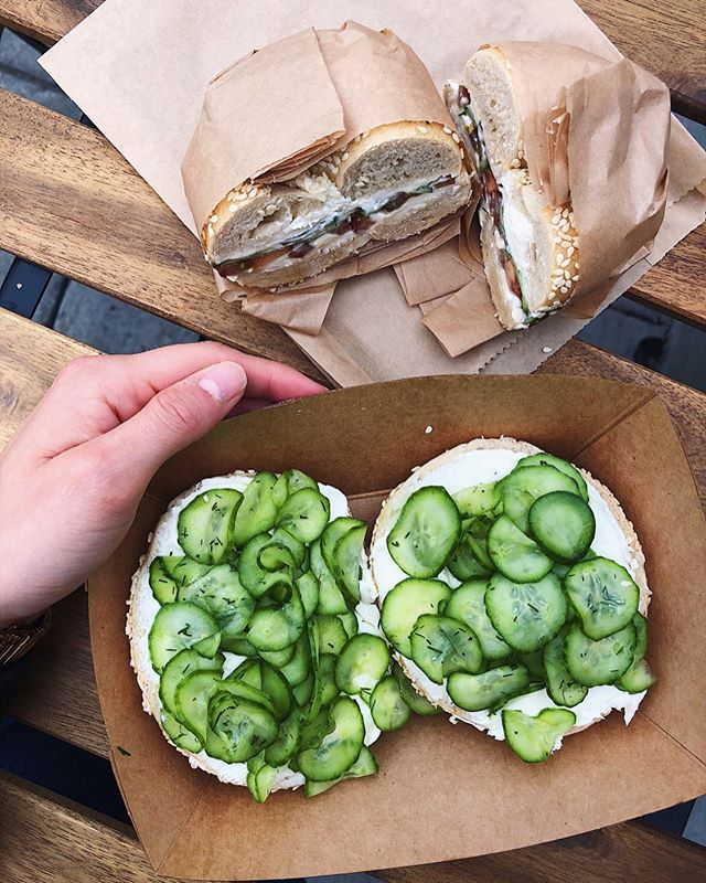 "GBOAT (greatest bagel of all time) thanks to @maurys_losangeles: a fresh sesame bagel (so fresh it doesn't need to be toasted), topped with cream cheese, cucumbers, dill, salt and pepper + another of the same, but sandwiched together with tomatoes 😍 A lotta the time when I crave bagels, I get way too in my head about them, especially with cream cheese. I worry about ""how many calories"" or ""carbs"" I'm eating... While sometimes I end up avoiding them altogether (I'm definitely not perfect), sometimes I do things like sneak in veggies (like the best cucumbers I've ever had), which always makes me feel a lil better. Maybe it's not the best method, and it's definitely not a permanent solution, but it helps me relax. Remember: Stepping stones are important too! Happy #ToastTuesday all! ♥️"