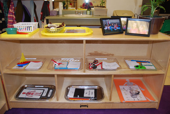 A TYPICAL SCIENCE SHELF IN A MONTESSORI ENVIRONMENT