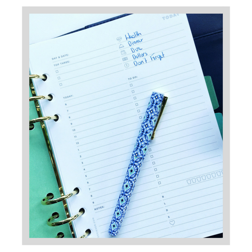 The Day Designer ring-bound A5 planner page