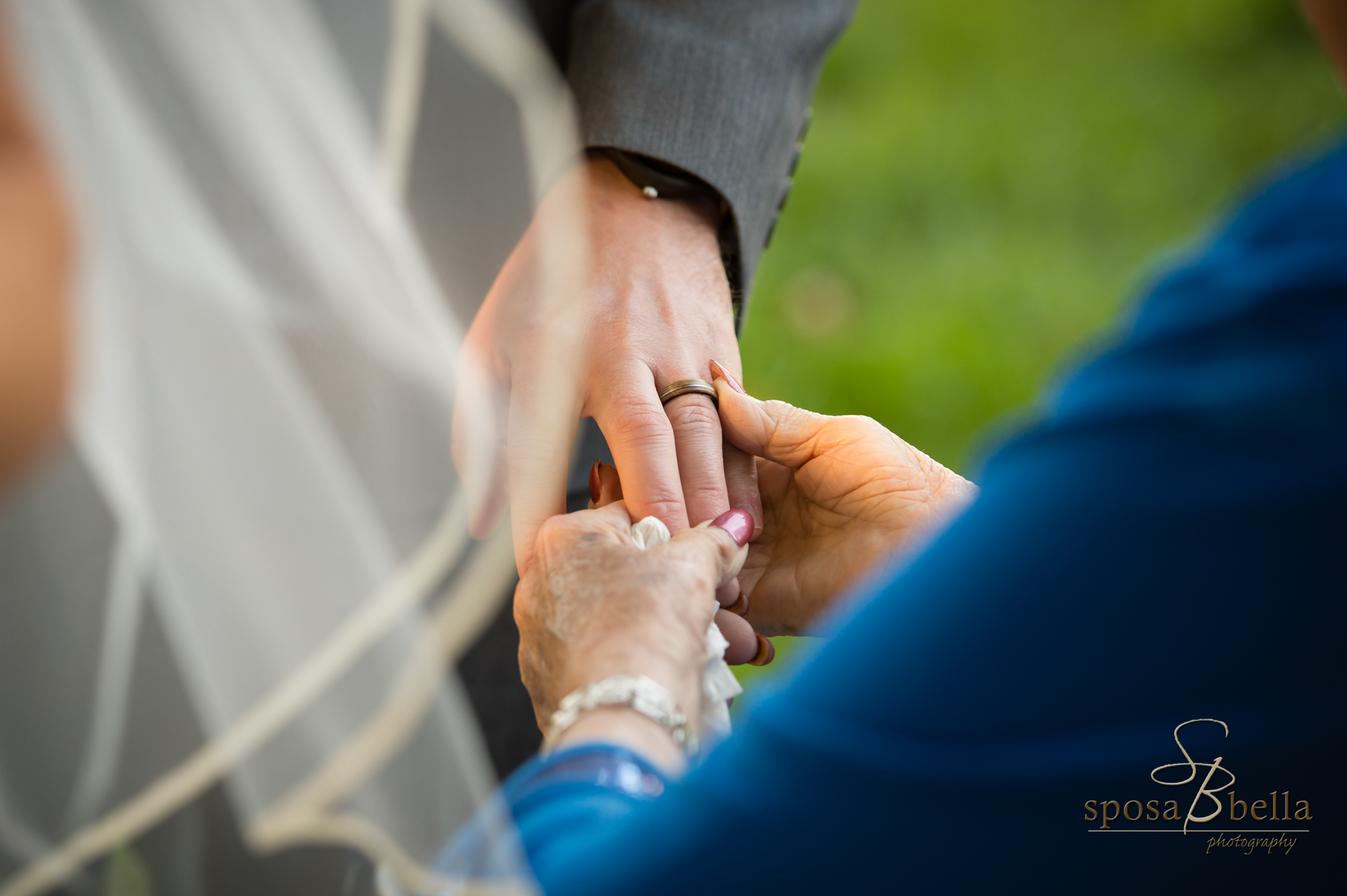 A beautiful moment captured as a Grandmother admires the Groom's new accessory.