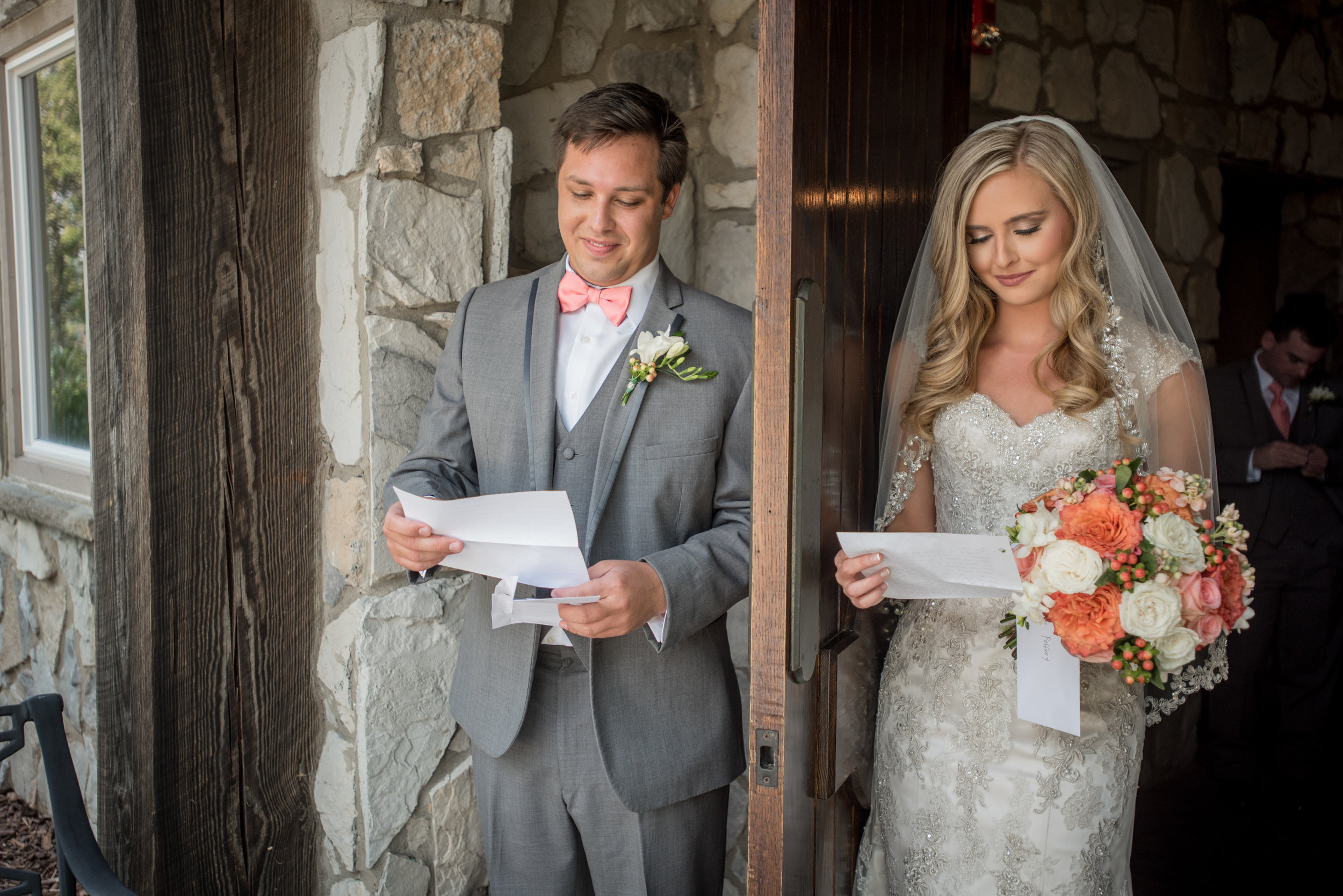 Instead of a first look, Leah & Alex chose to read letters from each other while standing on opposite sides of a door. This allowed Todd from Magnolia Studios to capture an intimate moment with the couple without them seeing one another before the ceremony.