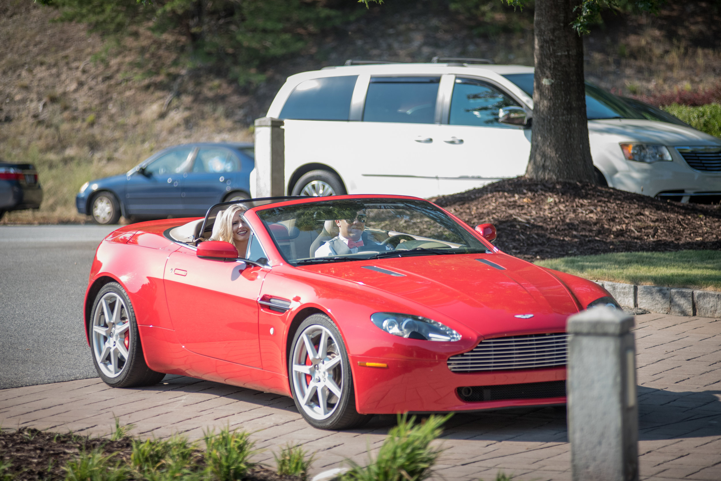 Prior to being introduced into the reception, our couple drove to the Lakehouse in style in a beautiful Aston Martin V8 Vantage Convertible.