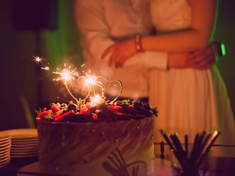 Placing sparklers on top of your wedding cake is a clever way to direct your guests attention to the cake table.  Looking for fun ways to add flare to your big day?  Find unique ideas at dancingbrides.com
