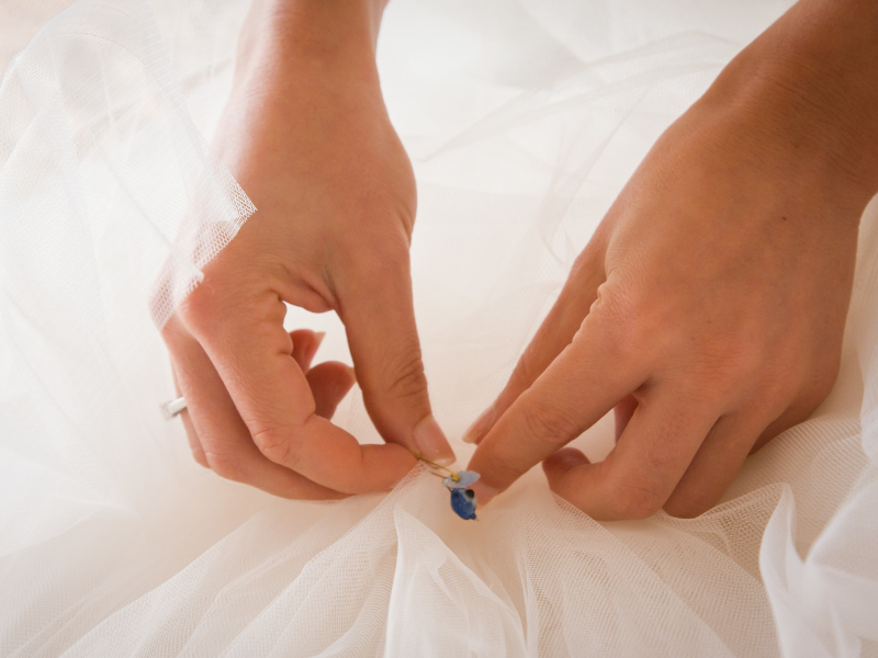 Looking for ideas for your something blue?  Pinning something blue inside your wedding dress is a smart way to keep it hidden throughout your special day.   Find more ideas at dancingbrides.com