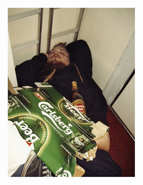 (Little John asleep on the cabin floor with a bottle of rum.)