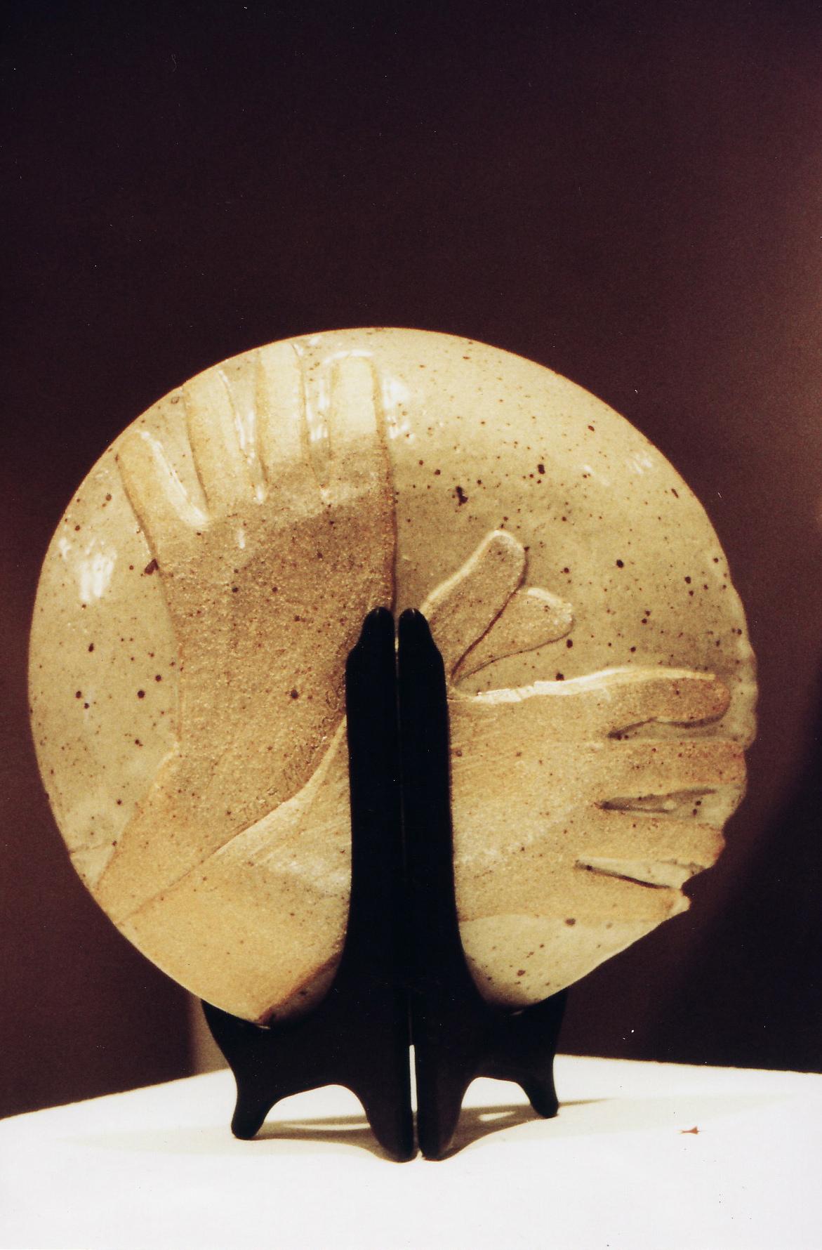 Winged hands plate.jpg