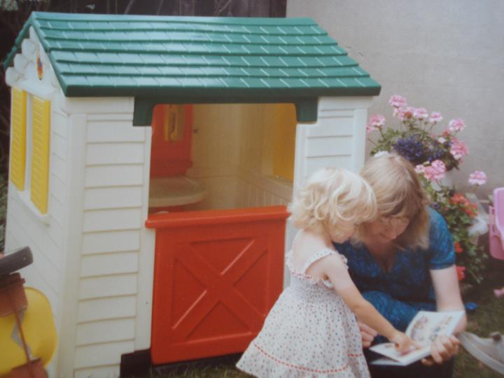 Me circa 1990 with my mum, with one of my favourite picture books and wendy house