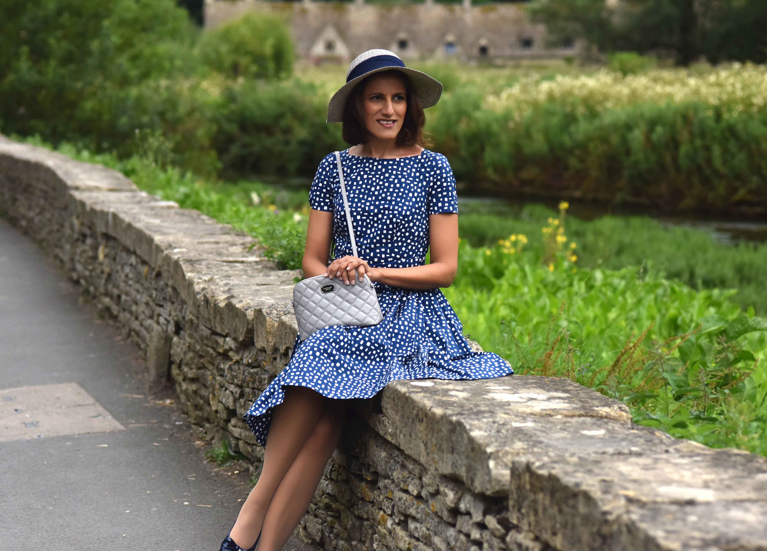 Prada dress, Michael Kors quilted cross body, Bibury, Cotswold, England. Image©thingstodot.com