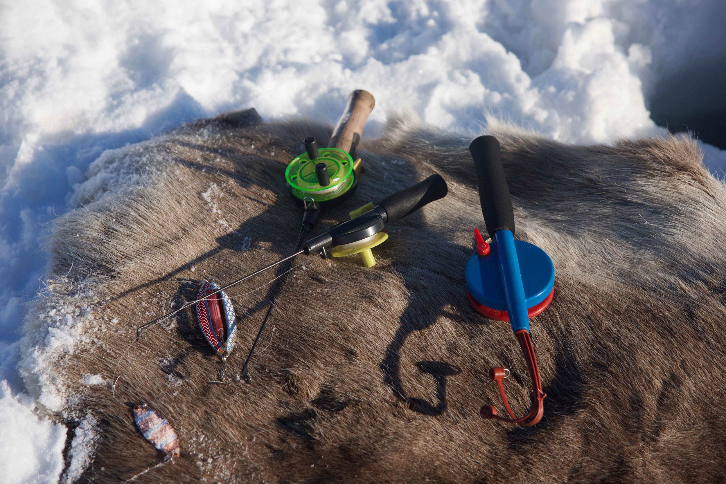 Arctic fishing, high frozen lakes, Arctic Circle, organized by Lyngen Lodge, Norway. Image©thingstodot.com