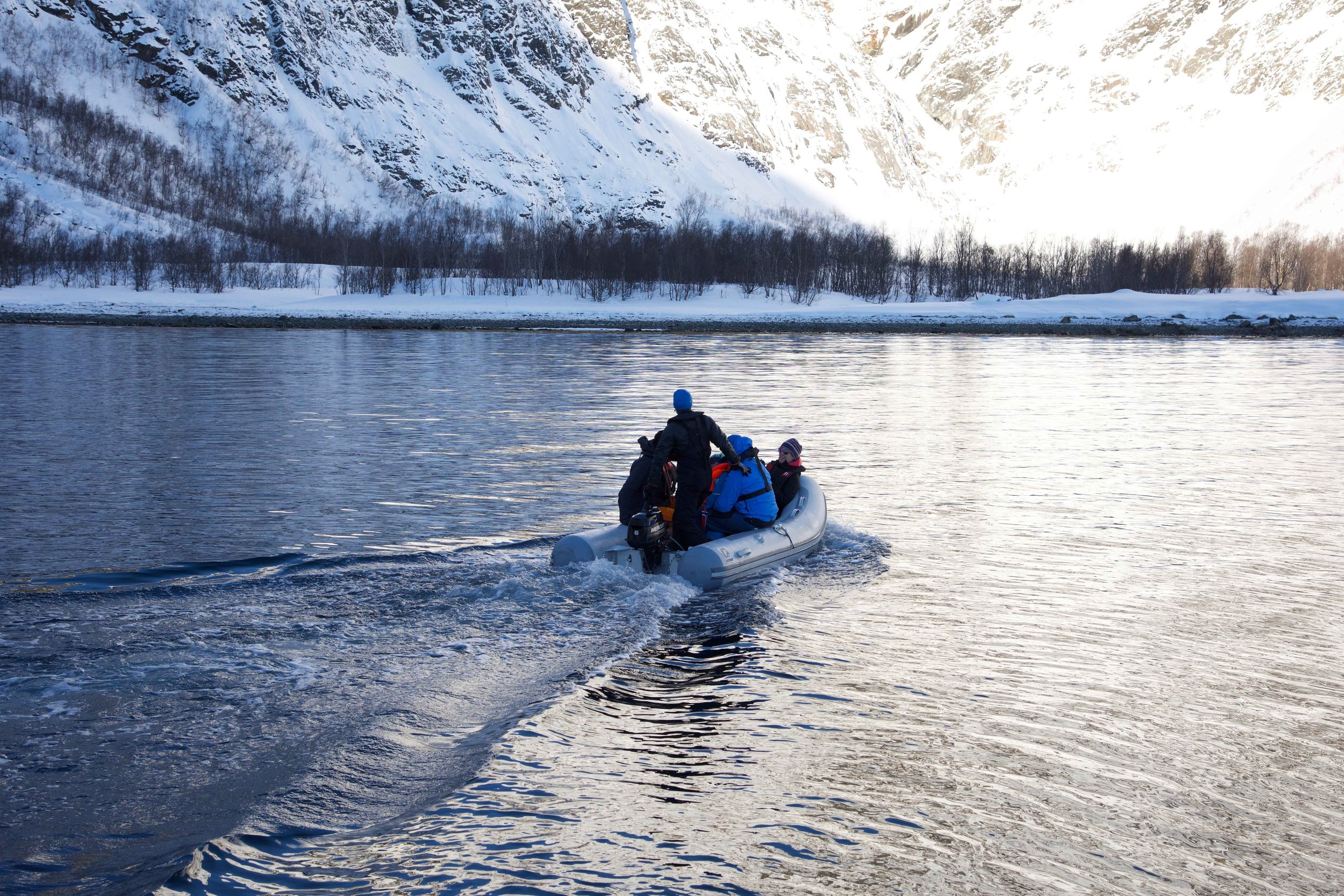 Skiers getting off, Lyngen fjords, organized by Lyngen Lodge, Arctic Circle, Norway.Image©thingstodot.com