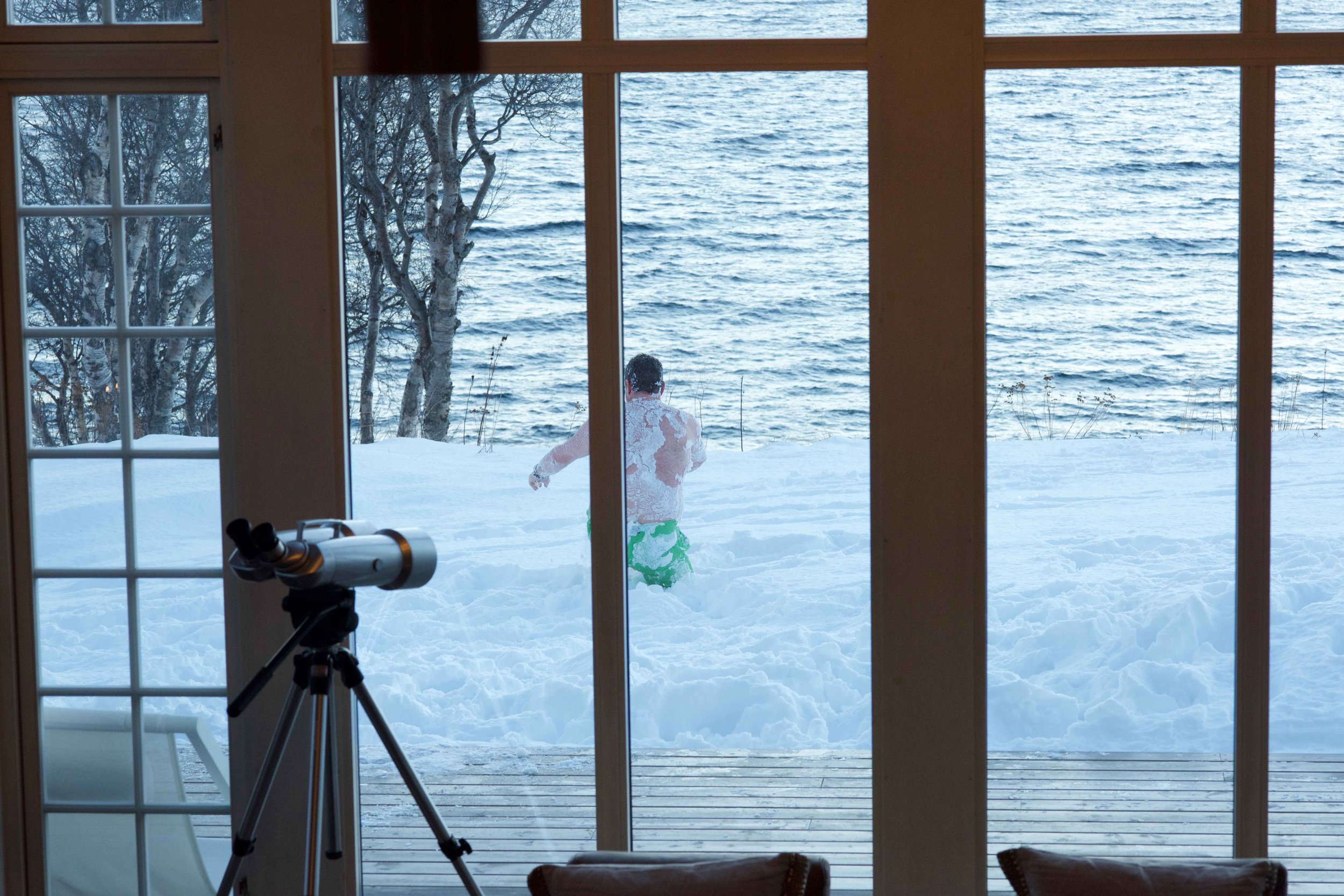 Rolling in snow, Arctic spa, Lyngen Lodge, Lyngen Fjords, Arctic Circle, Norway. Image©thingstodot.com