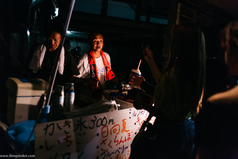Food stalls, Adachi Fireworks on Arakawa river, Tokyo, Japan. Image©www.thingstodot.com.