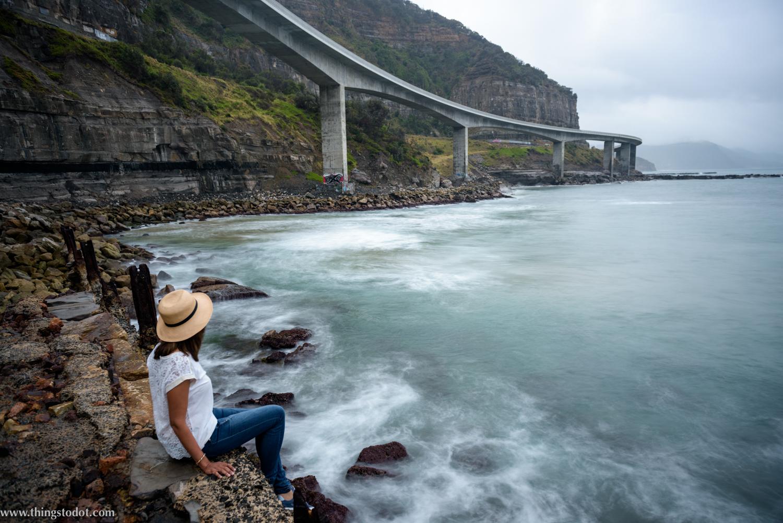 Sea Cliff Bridge, Coalcliff, New South Wales, Australia. Photo: Brad Chilby (http://chilby.com.au). Image©www.thingstodot.com. Clothing: https://www.cream-clothing.com.