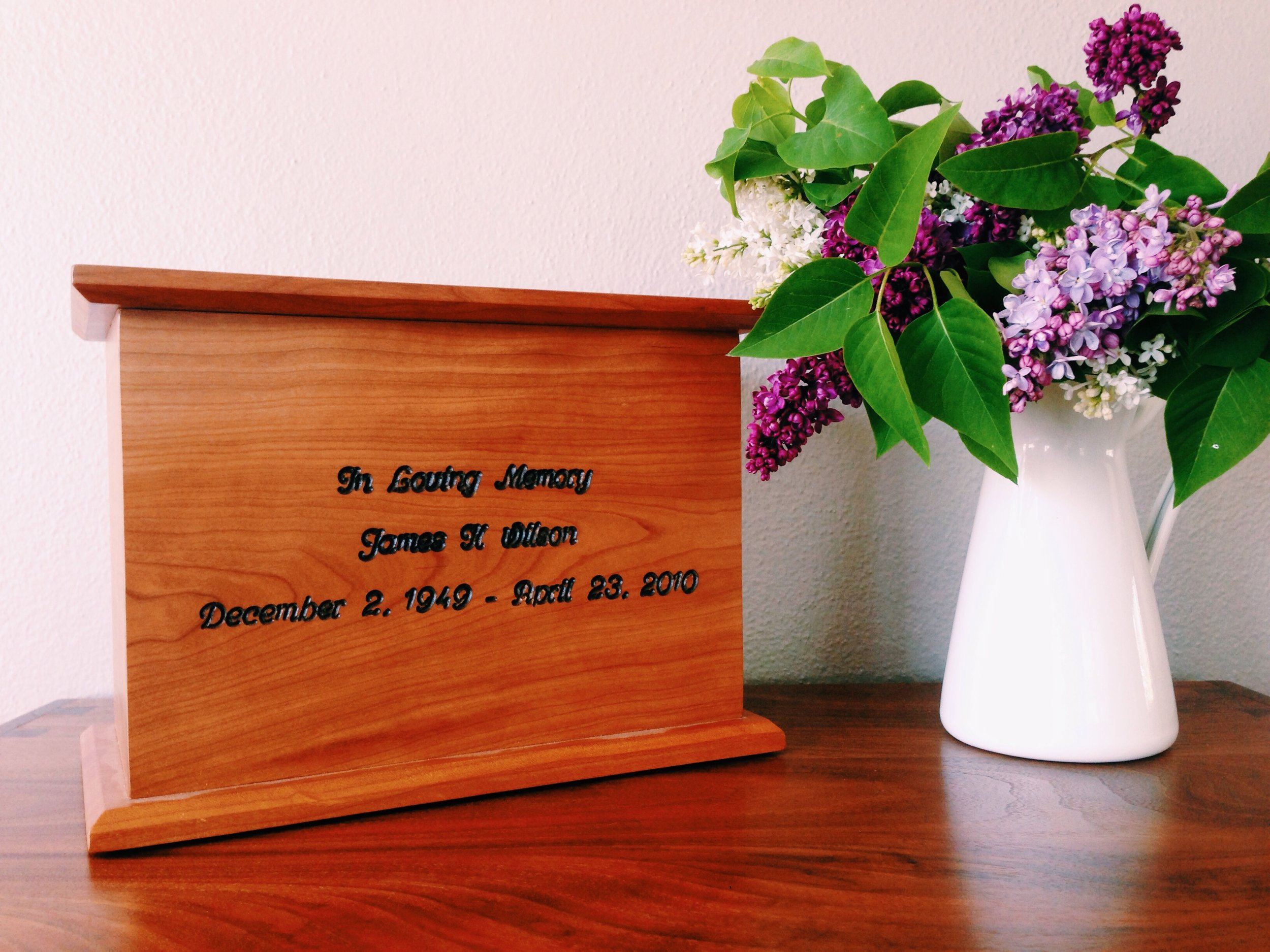 Custom engraving detailed in black on cherry Simplicity Urn