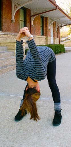 Kimberly demonstrates the version of Prasarita Padottanasana stretch.
