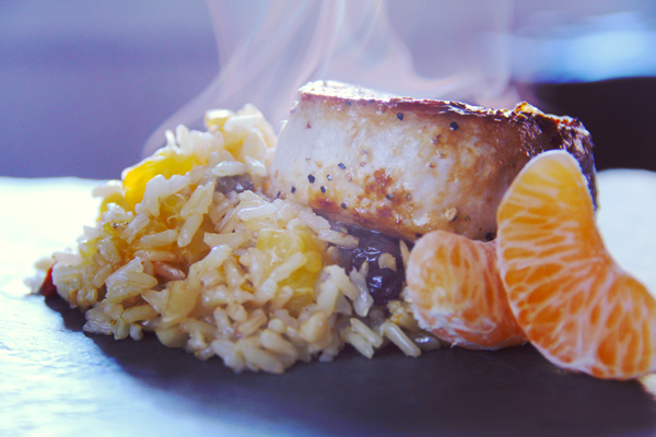 Pork Chops with Raisin, Almond, and Clementine Rice