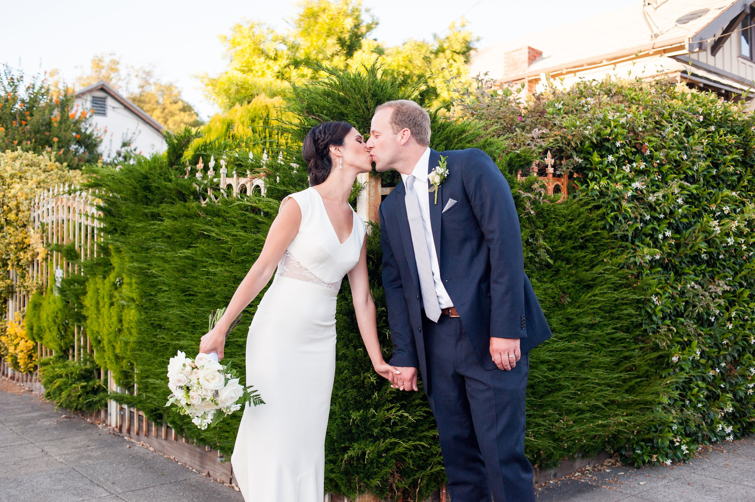 Bride and Groom kissing in Temescal neighborhood of North Oakland