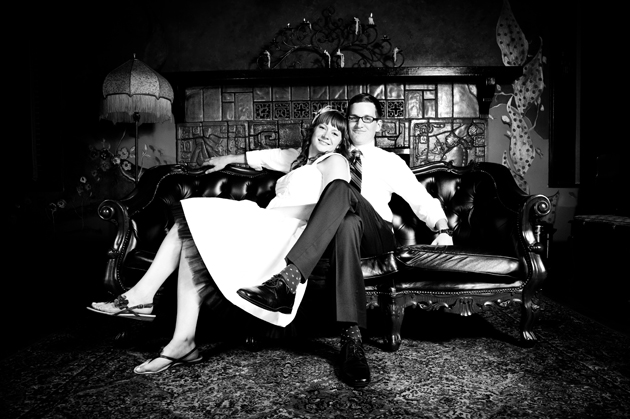 Portrait of bride and groom sitting on couch