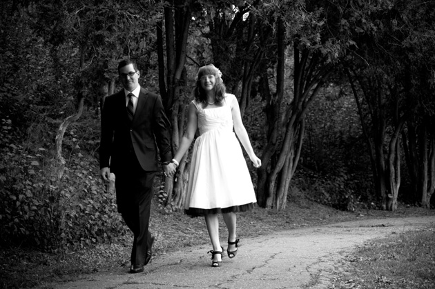 Bride and Groom walking in Oakland, CA. Photo by Oakland Wedding Photographer, e&b photography