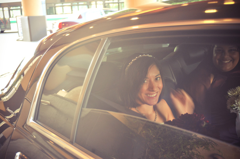 Bride looking out window of limo in Oakland, CA.  Photo by e&b photography