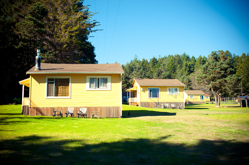 Yellow cabins at Mar Vista Cottages in Anchor Bay, CA