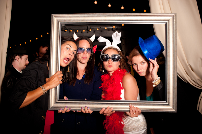 Bride with friends at photobooth