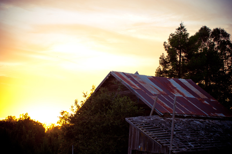 Sunset with barn in foreground